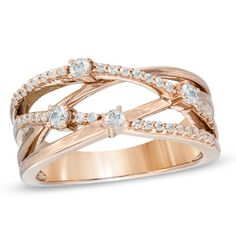 Right Hand ring :) 5 years is coming up babe!  1/3 CT. T.W. Diamond Orbit Band in 10K Rose Gold - Zales
