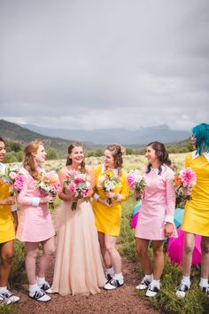 Ridgway State Park Wedding // Leah & Evan via Rocky Mountain Bride // vintage bridesmaid dresses // pink, yellow wedding // dahlia, rose, greenery bouquets // The Light + Color Photography