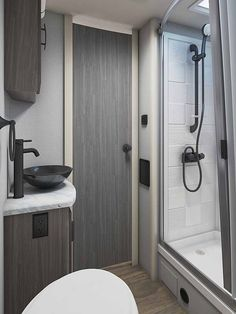 The Lance 2075 Travel Trailer comes with a very modern bathroom with plenty of space and storage for all your travel necessities! Lance Campers, Rv Show, Travel Necessities, Rv Accessories, Construction Design, Truck Camper, Travel Trailers, Tailgating, Modern Bathroom