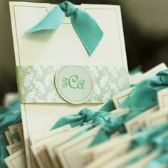 Pullout invites with ribbon at the end.
