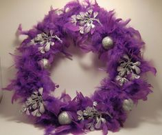 A feather wreath for Christmas made with dollar store supplies.