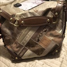 Patchwork Coach Purse Brown and tan patchwork shoulder bag. Neutral to match with all outfits. Some wear on bottom but still has lots of life left. Inside and the rest of the bag is in great condition. See picture for wear on the bottom. Coach Bags Shoulder Bags