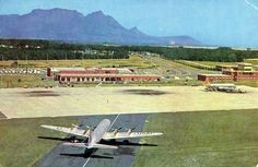 Cape Town Airport, with the SAA plane with orange tail to the right