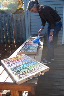 Marla Baggetta cleaning pastels with a feather duster.
