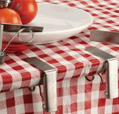 Set of 4 spring loaded stainless steel tablecloth clips.