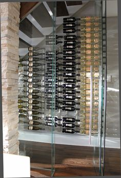 wine under the stairs display... potential sitting area upstairs providing additional aesthetic storage