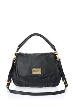 Best purse ever. One of our best sellers, the Classic Q Ukita is a key Marc by Marc Jacobs accessory and the perfect slouchy shoulder bag. The Ukita features our signature logo plaque detailing, as well as a detachable cross-body strap allowing the bag to be worn on the shoulder or as a cross-body.100% Cow Leather.