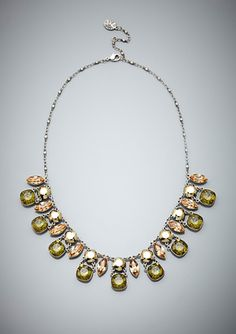 """ANNE KOPLIK Stunning Tri-Colored Necklace       Designed exclusively for ideeli      Made with Swarovski Elements      Bib necklace      Features crystals in khaki, light metallic gold, and olive tones in marquise and cushion cuts      Hand-made      Lobster clasp closure      Nickel- and lead-free      Comes in a polyester bag    Material: Silver plating, Swarovski Elements  Approx. measurements: length 16"""", extension 2"""" , bib drop 1""""  Origin: Made in USA"""