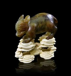88: A Jade Fox on Carved Ivory Stand, Height overall 1