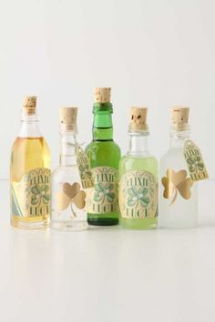 "Recycled airplane bottle w/carved tiny corks .. ""Good Luck Elixir"" for St Patrick's Day!"