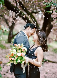 Pretty petal-filled spring engagement session: Photography : Rebecca Yale Photography Read More on SMP: http://www.stylemepretty.com/new-york-weddings/new-york-city/brooklyn/2016/07/29/a-rainy-day-nyc-engagement-session-that-will-make-you-believe-in-magic/
