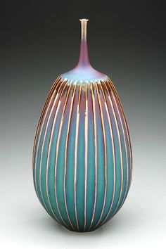Carved jar with blue hare's fur glaze by Hideaki Miyamura.  http://www.miyamurastudio.com
