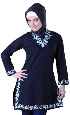 Featured here is a beautiful indigo kurti. This beautiful cotton poplin garment has been elegantly embroidered to offer the best for you. Smartly cut, this kurti has a young as well as rich feel to it.Floral embroiders on the length of this cotton poplin garment give it a kind of grace rarely found.