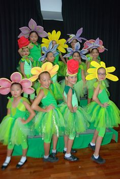 Flowers costumes.I made this flowers out of cushion foam and painted with acrylic paint.
