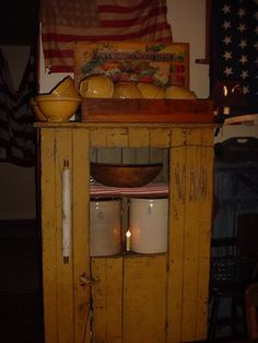 Worn Prim Mustard Cupboard...Yellow ware & Old Crocks...wood bowl.