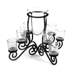 This Elements 8 Light Metal Candle Centerpiece features an attractive scroll design on the legs and will create pretty, illuminated patterns on a table, mantel, or shelf. The...