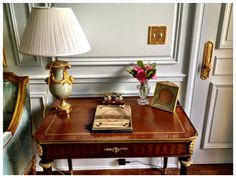 Desk area; Living Room.  Louis XVI style, French.  -19th century writing desk with ormolu detailing, France.  -19th century table lamp, ormolu & porcelain (originals at the Louvre).  -Baccarat small flower vase