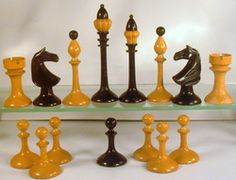 Thin bodied turned and carved chess set.