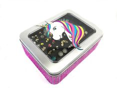 This Unicorn Tin Jewelry Box is perfect for all girls who are dreamy about Unicorns. The Hot Pink Jeweled Ribbon sparkles with delight and is the perfect size to secure and store your stud earrings when traveling or just to put in a drawer or display on your dresser. The custom foam