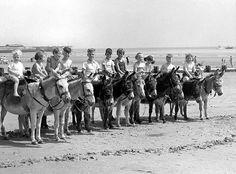 Children sitting on donkeys on Bridlington Beach in East Yorkshire, 1950s