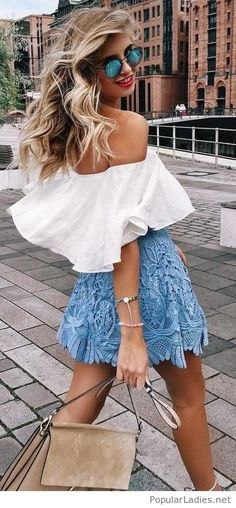 White top, blue skirt and a bag