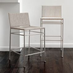 """Shop Bounce White Woven Bar Stool. White rope bar stools by Kara Mann sport a rectilinear profile and monochromatic style. """"To me, they're not pretentious. They're so simple, they fit anywhere,"""" Kara says. """"There's an aging quality about rope."""
