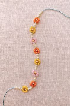 Honestly, is there anything happier than daisies? I was desperately needing a dose of happy over the weekend and whipped up a few colorful bracelets to soothe the soul. Making daisy chains from seed beads… Jewelry Tags, Cute Jewelry, Jewelry Necklaces, Geek Jewelry, Bead Jewellery, Beaded Jewelry, Metal Jewelry, Beaded Anklets, Old Jewelry