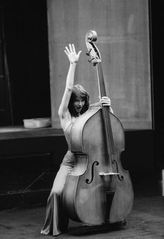 Kate Bush doing her thing with a double bass in 1980 · nerdsfun. Acoustic Guitar Lessons, Violin Lessons, Guitar Logo, Guitar Tabs, Guitar Notes, Guitar Tattoo, Musician Photography, Guitar Girl, Double Bass