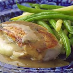 Chicken Breast stuffed with Carmelized Red Onions & Fontina Cheese and topped with a chicken & white wine gravy.