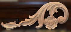 carved wood scroll