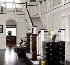 Portfolio   Noelle Micek Interiors   beautiful and classic entry with dark floors and gorgeous mouldings. Love the white millwork! gorgeous!