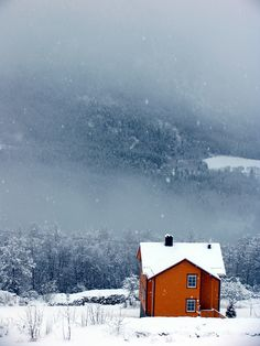 Orange house in the snowy mountain countryside
