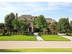 1873 POST OAK PLACE WESTLAKE, TX 76262 - $3,795,000  1.18 acre golf course lot with excellent privacy in Vaquero. Traditional styled home with superb quality construction & finishes. Master suite features separate his & hers master baths and sitting room. 1200 sq ft guest house has living room, full kitchen, laundry, bedroom & bath with its own motor court. The backyard features a beautiful pool and spa, a sport court, outdoor kitchen and covered patio area with fireplace & television.