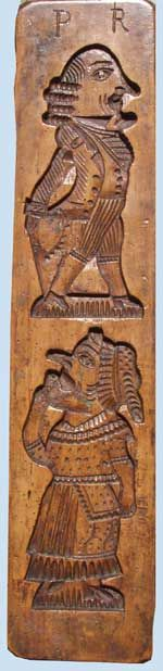 A nineteenth century pearwood mould for making Punch and Judy gingerbreads...what a great piece and I sure would love to have one like it!