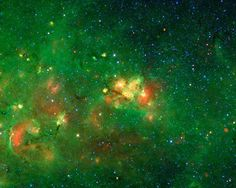 The bright yellow-red nebula at the center of this image is in the constellation of Scutum, and has no common name since it is hidden behind dust clouds. It takes an infrared telescope like Spitzer, which sees beyond the visible spectrum of light, to see through this dark veil and reveal this spectacular hidden nebula.