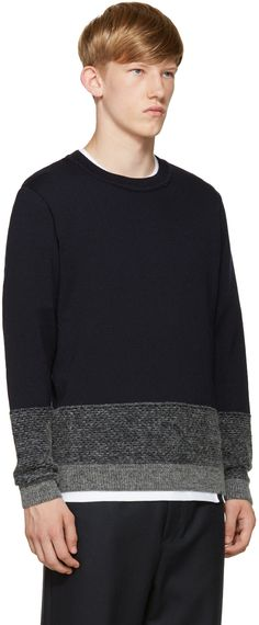 Long sleeve knit sweater in navy. Ribbed crewneck collar, sleeve cuffs, and hem. Contrasting marled knit panels in grey at sleeve cuffs and hem. Tonal stitching.