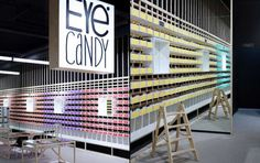 Customers who purchase a pair of glasses at the Eye Candy shop in Belgium get to actually take the glasses' corresponding box from the wall and take it home. Essentially, the customer, according to Creneau International, becomes a walking ad for the store.