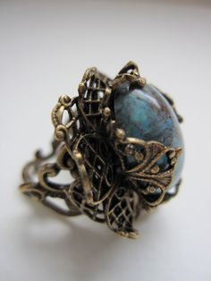 Turquoise Ring. is love something untraditional. Maybe a few small white diamonds on the side