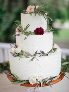 Think greenery with an earthy essence of ranunculus and lavender for a boho wedding cake garnish.