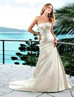 You will turn heads walking down the aisle in this amazing sheath wedding gown crafted of soft, flowing Organza. This designer gown's gorgeous keyhole-back is highly-defined and the silhouette offers figure-flattering ruching throughout the bodice and waist. A detachable beaded belt adds even more intrigue to this truly unique dress.