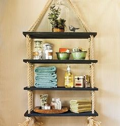 DIY rope shelf. Just make sure you hang it from a joist in your ceiling or it will come crashing down on you.