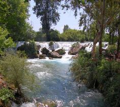 Falls on the Berdan River at Tarsus, Turkey. Restaurant with outdoor eating area right on the river near the falls.