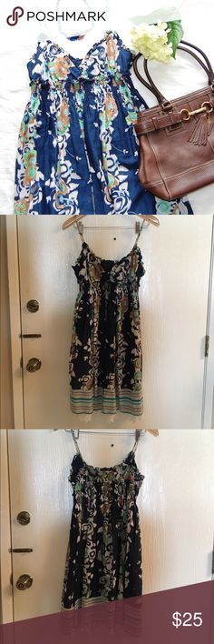 BCBGMAXAZRIA Baby Doll Dress Super cute baby doll dress with adjustable straps. Navy blue with floral print. Elastic empire waist and under skirt has a lace lining. 100% cotton. This is a reposh as it's too tight on me, even though it says M. Super soft. Never worn but has been dry cleaned. BCBGMaxAzria Dresses