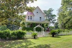Nestled on 1.69 acres and surrounded by majestic oak trees, this Victorian cottage could be right out of a fairytale.