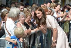 Kate leans in for a chat with members of the public who had lined the streets…