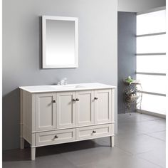 The 48-inch Windham Bathroom Vanity is defined by its soft white lacquer finish, brushed nickel rounded square knobs and casual contemporary look. This beautiful assembled vanity provides a large storage area behind four doors.