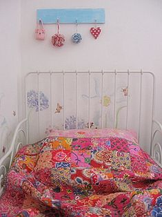 Adore this little quilt.  Tutorial for the cloth balls above the bed, too.