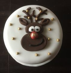 christmas cake traditional Christmas fruit cake, marzipaned and fondant iced. Rudolph head made with chocolate flavoured fondant . Golden balls and edible glitter added. Christmas Themed Cake, Christmas Cake Designs, Christmas Cake Decorations, Christmas Cupcakes, Holiday Cakes, Christmas Desserts, Christmas Treats, Xmas Cakes, Edible Glitter