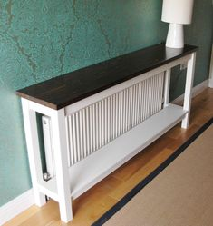 10 Cool Ways To Improve Your Home With a DIY Radiator Cover - Narrow table to cover the radiator Best Picture For Home diy bedroom For Your Taste You are looki - Diy Radiator Cover, Radiator Shelf, Radiator Ideas, Painted Radiator, Radiator Cap, Kitchen Radiator, Diy Deco Rangement, Narrow Table, Diy Home Decor