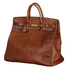 Hermes, Paris HAC Ostrich Travel Bag. Oh i just love ostrich so much. Id make em an endangered species with all the bag and shoe buying i could do!!